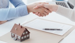 mortgage handshake paperwork