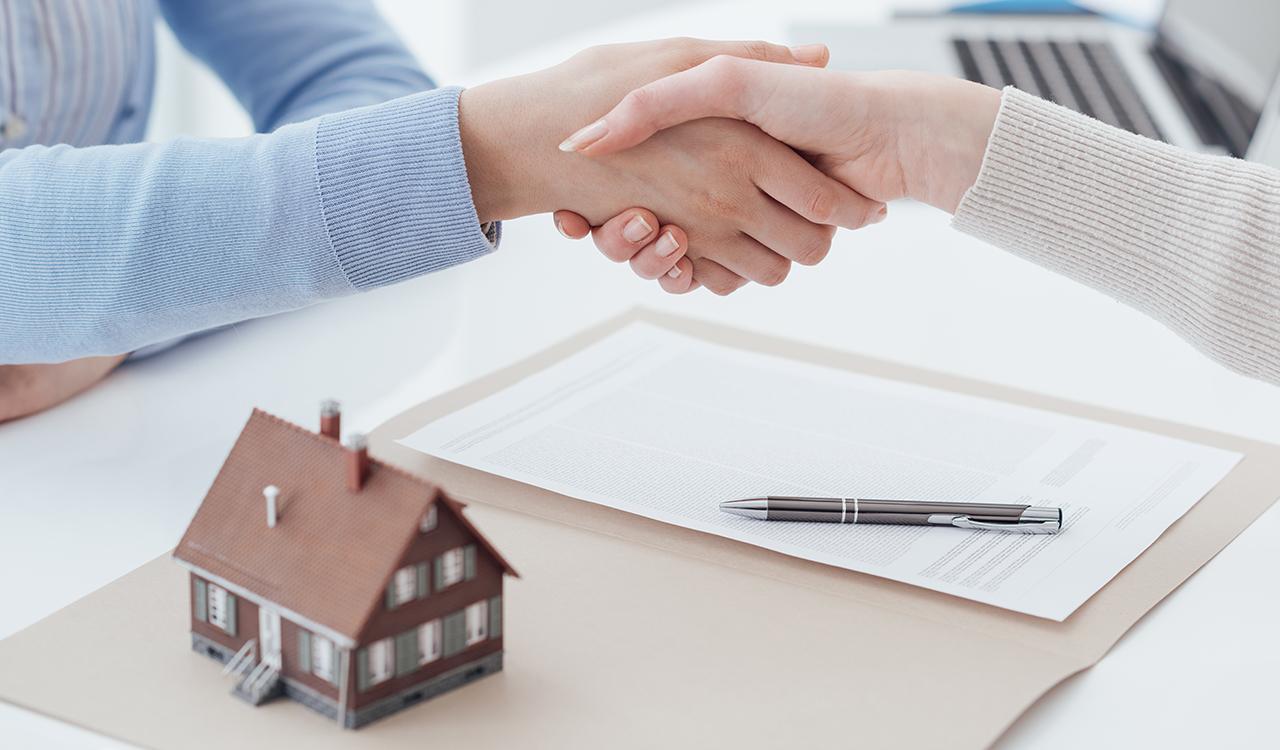 mortgage handshake paperwork